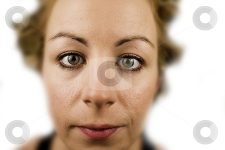 Extreme Closeup stock photo, Extreme closeup of a young woman in front of white background by Scott Griessel