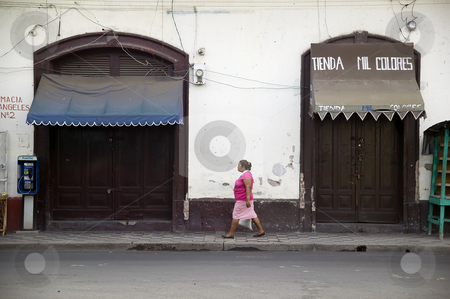 Woman on the Street in Granada Nicaragua stock photo, Woman walkson an urban street in Granada Nicaragua by Scott Griessel
