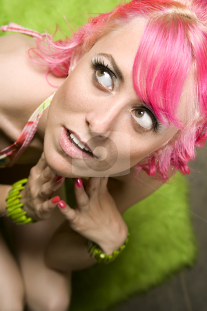Pretty Woman with Pink Hair stock photo, Closeup of Pretty Woman with Pink Hair on Green Rug by Scott Griessel