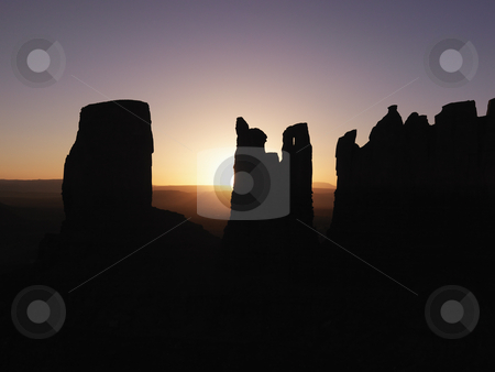 Monument Valley mesa sunset landscape. stock photo, Scenic sunset landscape of mesas in Monument Valley near the border of Arizona and Utah, United States. by Iofoto Images