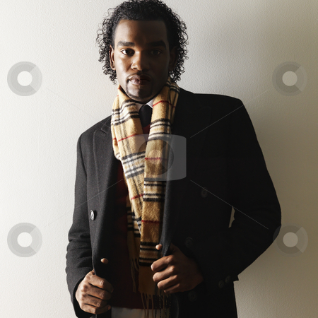 Stylish man stock photo, Portrait of man in dress attire and scarf. by Iofoto Images