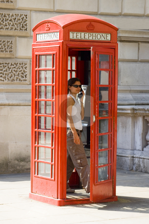 London's Telephone Box stock photo, Girl inside a traditional English red telephone box by Lee Torrens