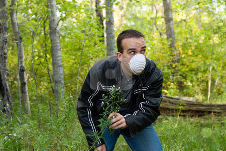 Unhealthy Man stock photo, A young man who has to wear a mask outside  to help protect himself from infectious diseases by Richard Nelson