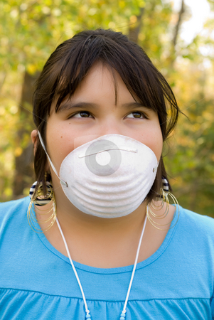 Face Mask stock photo, A nine year old girl wearing a face mask outside by Richard Nelson