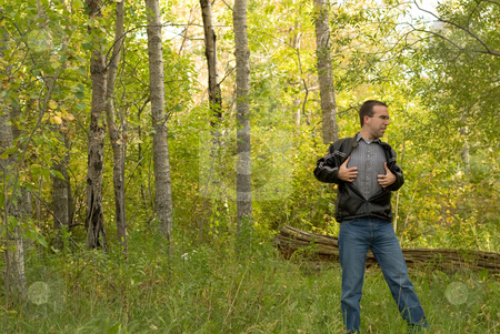 Poison Ivy stock photo, A man scratching his body because he got poison ivy through his shirt by Richard Nelson
