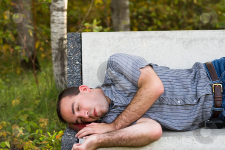 Tired Student stock photo, A tired student taking a nap on his break by Richard Nelson