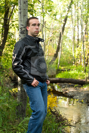 Alone stock photo, A young man wanting to be alone in nature by Richard Nelson