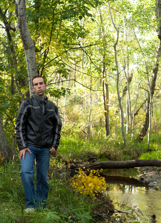 Depressed Man stock photo, A depressed man standing by a beautiful stream by Richard Nelson
