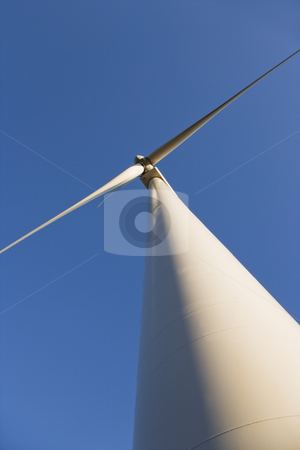 Low angle of wind turbine. stock photo, Perspective shot of wind turbine against blue sky. by Iofoto Images