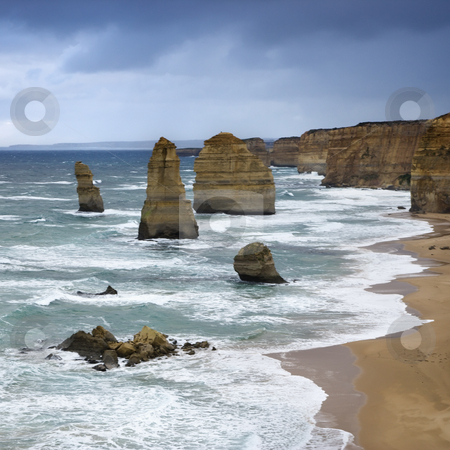 Rock formations in ocean. stock photo, Twelve Apostles rock formation on coastline as seen from the Great Ocean Road, Australia. by Iofoto Images