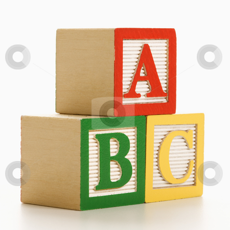 Building blocks. stock photo, ABC alphabet blocks stacked together. by Iofoto Images
