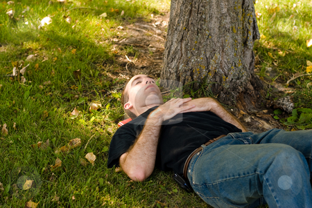 Dozing Off stock photo, A young man dozing off, under a tree by Richard Nelson