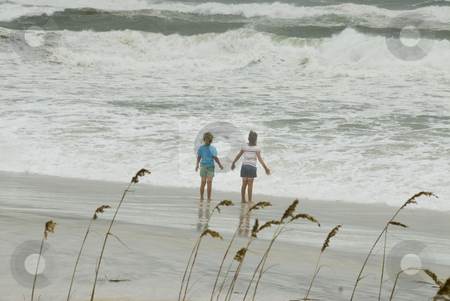 Gustav Girls stock photo, PENSACOLA - SEP 1: Two girls stand near the dangerous surf during Hurricane Gustav on September 1, 2008. Gustav claimed the lives of over 130 people. by A Cotton Photo