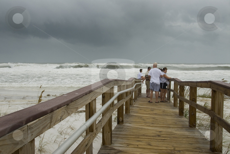 Gustav Walkway stock photo, PENSACOLA - SEP 1: Spectators watch from the beach walkway while Hurricane Gustav rolls in on September 1, 2008. Gustav damage is estimated in excess of $20 billion. by A Cotton Photo