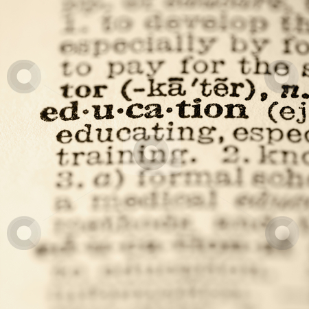Education dictionary entry. stock photo, Selective focus of dictionary definition for the word education. by Iofoto Images