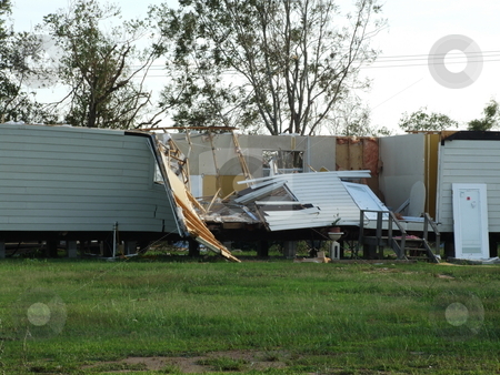 Hurricane Destroyed Home stock photo, Hurricane Ike's 105 miles per hour winds ripped the roof off this mobile home and crushed the center of the home. by Marburg
