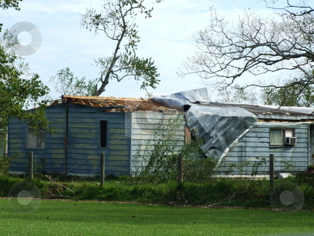 Hurricane Damaged Home stock photo, One of many tornadoes touched down after Hurricane Ike passed over.  A tornado peeled back the roof on this home. by Marburg