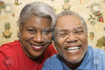 Mature couple smiling. stock photo, Close up portrait of mature African American couple smiling at viewer. by Iofoto Images
