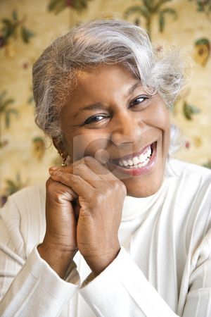 Smiling woman. stock photo, Portrait of mature African American woman smiling at the viewer. by Iofoto Images