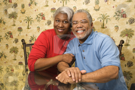 Mature couple. stock photo, Portrait of mature African American couple embracing and smiling at viewer. by Iofoto Images
