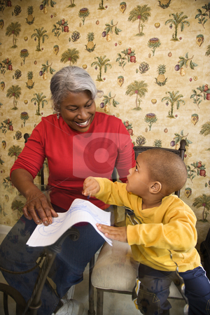 Grandmother and grandson coloring. stock photo, Portrait of African American grandmother with grandson coloring. by Iofoto Images