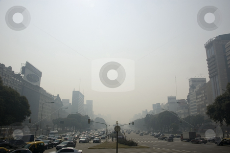 Buenos Aires clouded in smoke stock photo, The city of Buenos Aires is clouded in smoke from nearby farms burning off to renew fields ready for Soya Bean plantation. by Lee Torrens