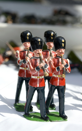 Toy Soldiers stock photo, Collection of small toy figurines of typical English soldier marching band by Lee Torrens