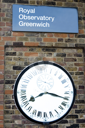 Clock at the Royal Observatory of Greenwich stock photo, Clock at the wall with sign at Greenwich by Lee Torrens