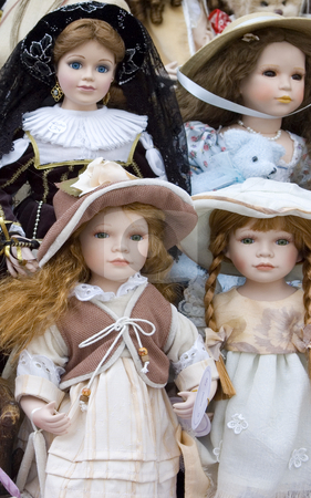 Delicate Dolls stock photo, Four delicate dolls on display by Lee Torrens