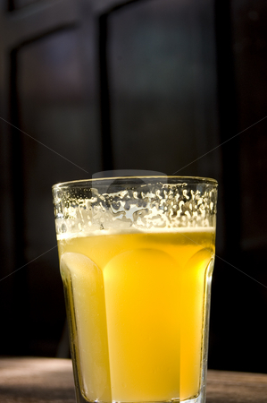 Pub Beer stock photo, Typical pub seen with a beer in the foreground by Lee Torrens