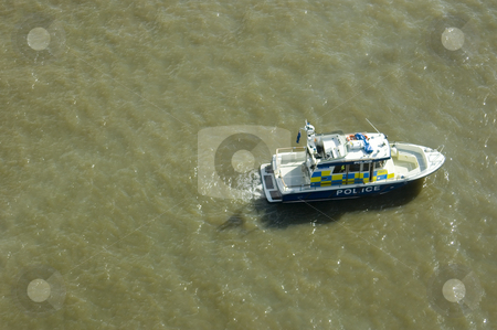 Police Boat stock photo, Police boat patrolling the Thames river (London) by Lee Torrens
