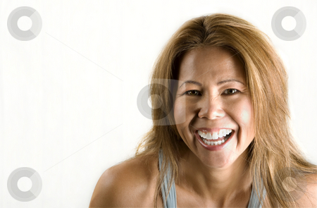 Ethnic woman on white background stock photo, Pretty ethnic woman with an easy smile by Scott Griessel