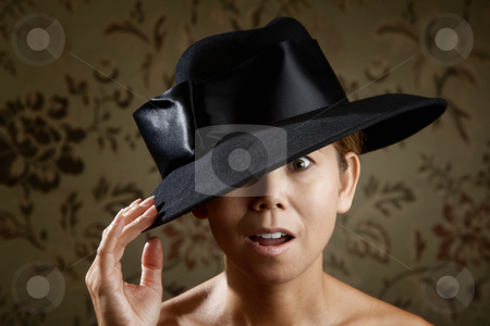 Ethnic woman in a black hat stock photo, Surprised ethnic woman in a big black hat by Scott Griessel