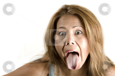 Ethnic woman sticking out her tongue stock photo, Pretty ethnic woman sticking out her tongue by Scott Griessel