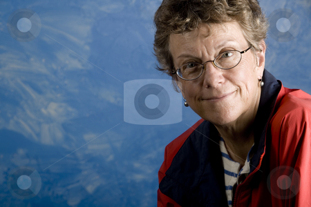 Portrait of a senior woman sailor stock photo, Portrait of a senior woman in her sailing clothes by Scott Griessel