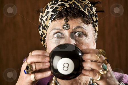 Gypsy predicting the future stock photo, Gypsy looking at an eight ball to predict the future by Scott Griessel