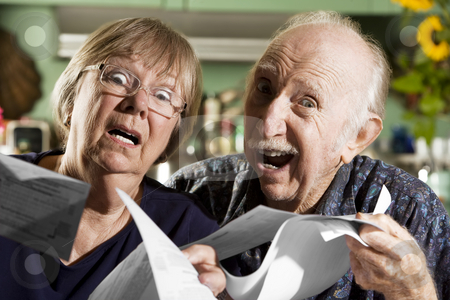 Elder Couple with Bills stock photo, Elder Couple at Home with Bills by Scott Griessel