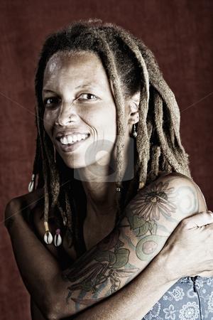 Woman with dreadlocks stock photo,  by Scott Griessel
