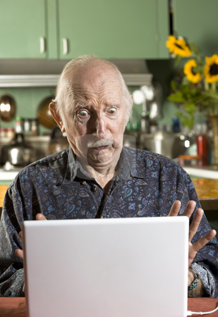 Shocked Senior Man with a Laptop Computer