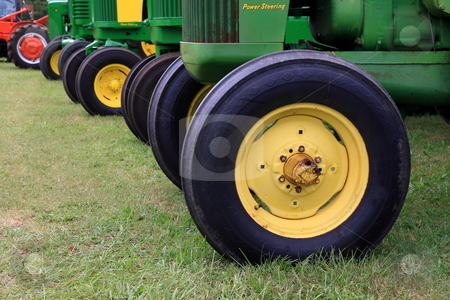 Tractors stock photo, Tractor wheels in line at a country farm show by Jack Schiffer