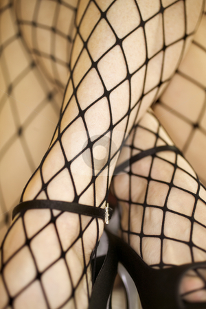 Fishnet stockings. stock photo, Close up of Caucasian woman in fishnet stockings and high heels. by Iofoto Images