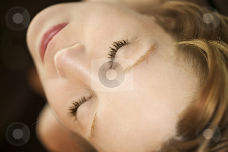 Portrait of woman. stock photo, Close up portrait of pretty redhead Caucasian woman with eyes closed. by Iofoto Images