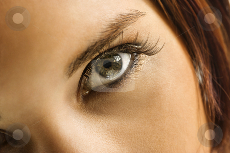 Woman's eye. stock photo, Close up of young Caucasian woman's green eye with makeup. by Iofoto Images