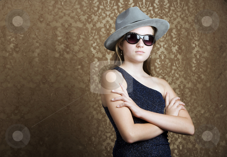 Young girl dressed in spy gear stock photo, Young girl wearing a fedora and dark sunglasses by Scott Griessel