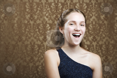 Confident Young Girl Laughing stock photo, Confident Young Girl in a Party Dress Laughing by Scott Griessel