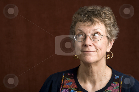 Woman with glasses looking up stock photo, Senior woman looking with glasses looking up by Scott Griessel
