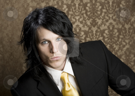 Handsome man in a business suit stock photo, Handsome man seated in a business suit by Scott Griessel