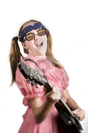 Young Girl with a Rock Guitar stock photo, Young girl in a pink dress with an electric rock guitar by Scott Griessel