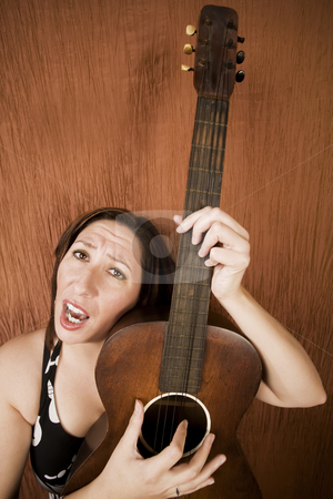 Funny Hispanic Folk Singer stock photo, Winde-angle shot of a funny Hispanic folk singer with guitar by Scott Griessel