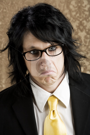 Unpleasant Young man stock photo, Young man with an unpleasant expression on his face by Scott Griessel
